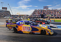 Sept. 24, 2011; Ennis, TX, USA: NHRA funny car driver Ron Capps (near lane) races alongside brother Jon Capps during qualifying for the Fall Nationals at the Texas Motorplex. Mandatory Credit: Mark J. Rebilas-