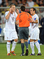 Michael Bradley (12) and Landon Donovan (right) of USA complain to referee Massimo Busacca (center) after he sent-off their team-mate Sacha Kljestan. Brazil defeated USA 3-0 during the FIFA Confederations Cup at Loftus Versfeld Stadium in Tshwane/Pretoria, South Africa on June 18, 2009.