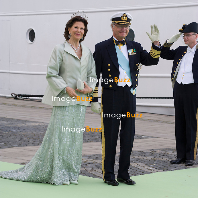 QUEEN SILVIA AND KING CARL GUSTAF<br /> arrive for a boat ride to Drottingholm Palace for the Wedding Banquet Riddarholmen, Stockholm, Sweden_08/06/2013<br /> Princess Madeleine married Christopher O'Neill at the Royal Chapel, Royal Palace in Stockholm