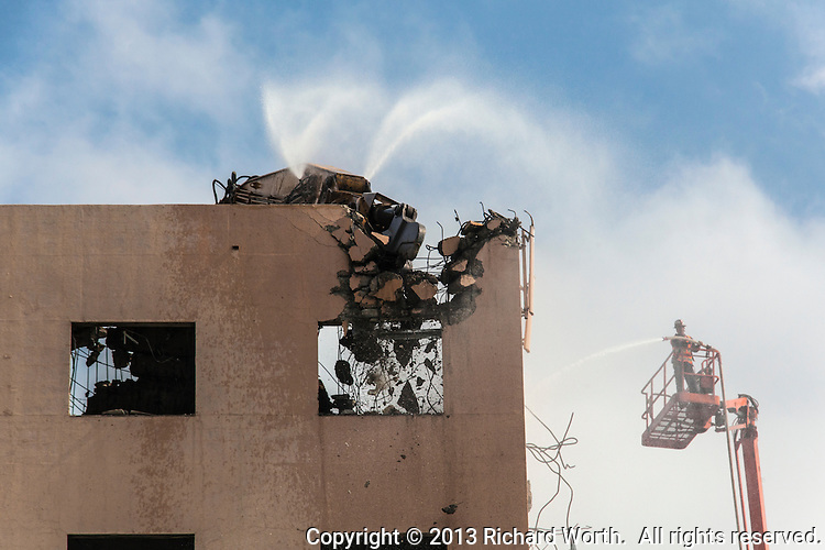 "Demolition in progress on the former Eden Hospital in Castro Valley, California.  At their website, Sutter Health refers to the process as deconstruction, ""because of the selective, targeted work involved and the recycling process—"""