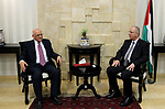 Palestinian Prime Minister Rami Hamdallah meets with Palestinian nuclear scientist Munir Naifah in the West Bank city of Ramallah on April 23, 2017. Photo by Prime Minister Office