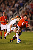 Wake Forest Demon Deacons forward Zack Schilawski (12) is chased by Virginia Tech Hokies defender James Shupp (4) during an NCAA College Cup semi-final match at SAS Stadium in Cary, NC on December 14, 2007. Wake Forest defeated Virginia Tech 2-0.