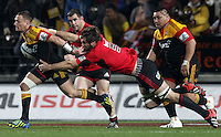 Chiefs' Aaron Cruden is tackled by Crusaders' Samuel Whitelock in the semi-final Super Rugby match, Waikato Stadium, Hamilton, New Zealand, Friday, July 27, 2012.  Credit:SNPA / David Rowland