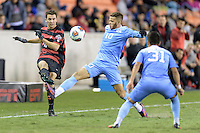 Houston, TX - Friday December 9, 2016: Adam Mosharrafa (16) of the Stanford Cardinal gets a kick off just before Zach Wright (10) of the North Carolina Tar Heels can block it at the NCAA Men's Soccer Semifinals at BBVA Compass Stadium in Houston Texas.