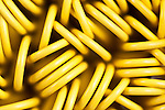 Container of yellow paper clips