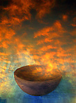 Creation metaphor illustrated by an ancient bowl and the sunrise.