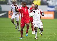 CARSON, CA - March 25, 2012: Harold Cummings (3) of Panama and Trevin Caesar (14) of Trinidad & Tobago during the Panama vs Trinidad & Tobago match at the Home Depot Center in Carson, California. Final score Panama 1, Trinidad & Tobago 1.