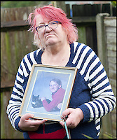 BNPS.co.uk (01202) 558833<br /> Picture: LauraJones/BNPS<br /> <br /> Pamela Young pictured with a photo of her son Andrew Young.<br /> <br /> Andrew Young, 40, became embroiled in an argument with Victor Ibitoye after he blasted him for riding his bike on the pavement.