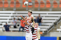 Houston, TX - Friday December 11, 2016: Jared Gilbey, (15) of the Stanford Cardinal and Ian Harkes (16) of the Wake Forest Demon Deacons go up for a header at the NCAA Men's Soccer Finals at BBVA Compass Stadium in Houston Texas.