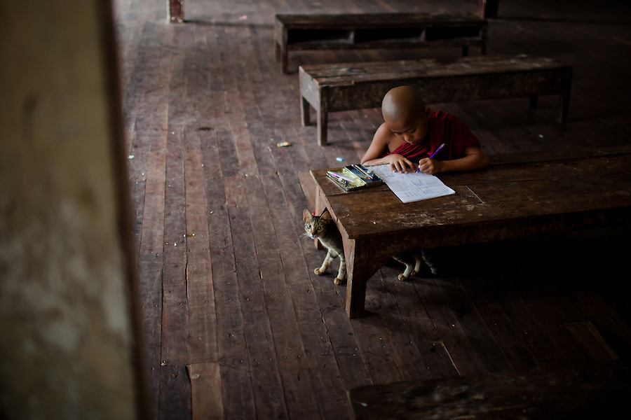 A youngster is one of the last to remain in class finishing a math test.