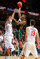 CHARLOTTESVILLE, VA- DECEMBER 6: Erik Copes #4 of the George Mason Patriots shoots between Akil Mitchell #25 of the Virginia Cavaliers and Sammy Zeglinski #13 of the Virginia Cavaliers during the game on December 6, 2011 at the John Paul Jones Arena in Charlottesville, Virginia. Virginia defeated George Mason 68-48. (Photo by Andrew Shurtleff/Getty Images) *** Local Caption *** Sammy Zeglinski;Akil Mitchell;Erik Copes
