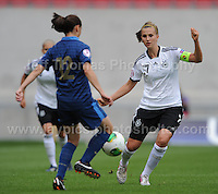 Charlene Gorce of France tackles Annabel Jager of Germany during the UEFA Womens U19 Semi-Final at Parc y Scarlets Wednesday 28th August 2013. All images are the copyright of Jeff Thomas Photography-www.jaypics.photoshelter.com-07837 386244-Any use of images must be authorised by the copyright owner.