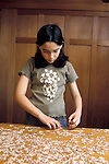 Berkeley CA Girl, 1/2 latina, 10-yrs-old working on very difficult jigsaw puzzle at home  MR