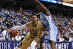 14 March 2015: Notre Dame's Zach Auguste (30) and North Carolina's Joel James (42). The Notre Dame Fighting Irish played the University of North Carolina Tar Heels in an NCAA Division I Men's basketball game at the Greensboro Coliseum in Greensboro, North Carolina in the ACC Men's Basketball Tournament quarterfinal game. Notre Dame won the game 90-82.
