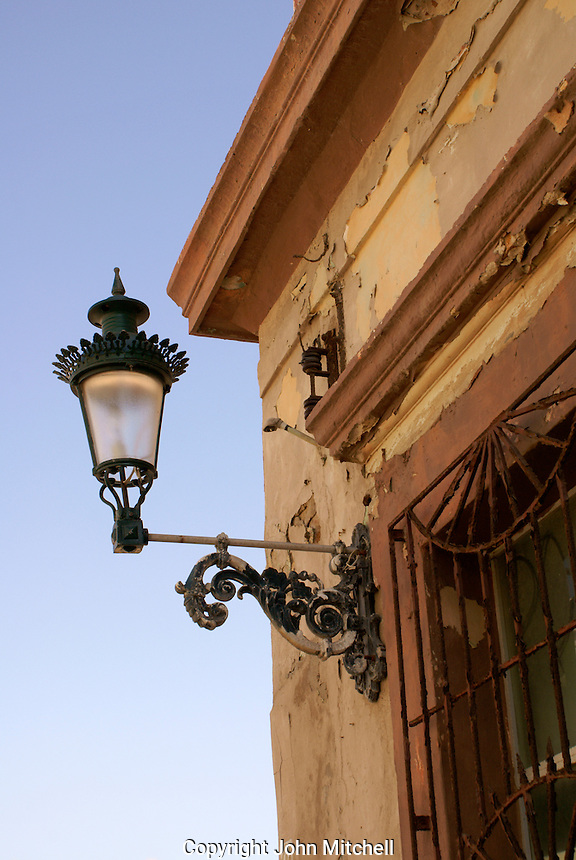 Metal lantern on the corner of a nineteenth century building in old Mazatlan, Sinaloa, Mexico