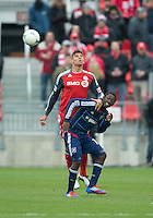21 April 2012: Chicago Fire forward Patrick Nyarko #14 and Toronto FC defender Adrian Cann #12 in action during a game between the Chicago Fire and Toronto FC at BMO Field in Toronto..The Chicago Fire won 3-2....