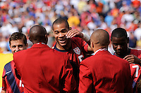 Oguchi Onyewu (5) of the United States greets Hall of Fame inductee Eddie Pope before the game. The men's national team of Spain (ESP) defeated the United States (USA) 4-0 during a International friendly at Gillette Stadium in Foxborough, MA, on June 04, 2011.