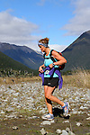 NELSON LAKES, NEW ZEALAND - APRIL 18:  Tonia Denize crosses the Travers River during the 2015 Alpine Lodge Loop The Lake trail run at Lake Rotoiti on April 18 16, 2015 in Nelson, New Zealand. (Photo by Marc Palmano/Shuttersport Limited)