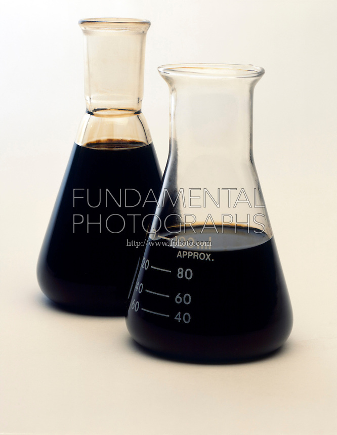 SAMPLES OF CRUDE OIL<br /> Sweet &amp; Sour Crude in  Flasks<br /> Similar in appearance, the sour crude (rear) has a strong rotten egg smell.