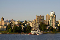 Old fashioned paddle boat or sternwheeler, Vancouver, British Columbia, Canada. West End highrises are in the background.