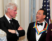 Yo-Yo Ma, one of the five recipients of the 2011 Kennedy Center Honors, right, listens to former United States President Bill Clinton, left, following a dinner hosted by U.S. Secretary of State Hillary Rodham Clinton at the U.S. Department of State in Washington, D.C. on Saturday, December 3, 2011. The 2011 honorees are actress Meryl Streep, singer Neil Diamond, actress Barbara Cook, musician Yo-Yo Ma, and musician Sonny Rollins..Credit: Ron Sachs / CNP