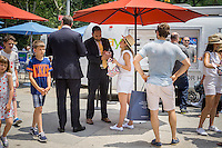 "Workers for eBay, iPads at the ready collect data from consumers at their ""Hot Deals for Hot Days"" promotion in Flatiron Plaza in New York on Tuesday, July 7, 2015. The branding promotion enables consumers to buy sunglasses at discounts corresponding to the high temperature of the day. Today's 83 F temperature gave buyers 83 percent off their purchase. (© Richard B. Levine)"