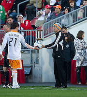 07 May 2011: Houston Dynamo head coach Dominic Kinnear gives the ball to Houston Dynamo defender Hunter Freeman #21 during an MLS game between the Houston Dynamo and the Toronto FC at BMO Field in Toronto, Ontario..Toronto FC won 2-1.