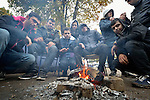Refugees and migrants gather around a fire to stay warm in a city park in Belgrade, Serbia. The park has filled with refugees from Syria, Afghanistan and other countries stopping over on their way to western Europe.