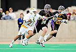 10 April 2011: University of Vermont Catamount midfielder Ahmad Zachary, a Freshman from Lower Merion, PA, in action against the University at Albany Great Danes on Moulton Winder Field in Burlington, Vermont. The Catamounts defeated the visiting Danes 11-6 in America East play. Mandatory Credit: Ed Wolfstein Photo