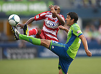 Jackson, left, of FC Dallas battles Leonardo Gonzalez of Seattle Sounders FC during play at CenturyLink Field in Seattle Saturday August, 3, 2013. The Sounders defeated Dallas 3-0.