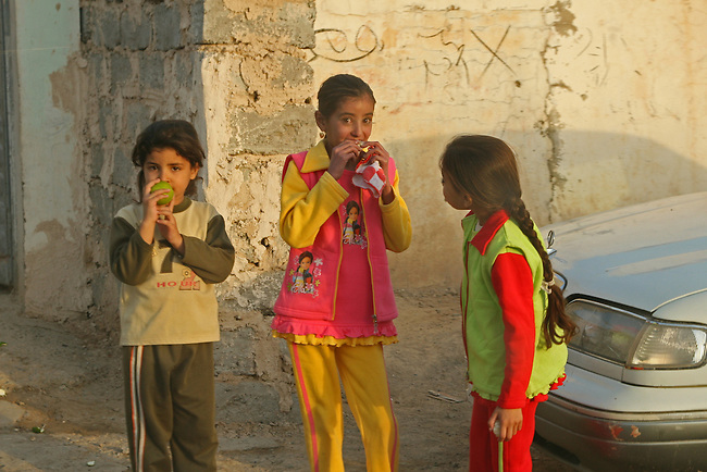 U.S. troops on Humvee patrol capture the attention of three girls in Samarra, Iraq. Soldiers with Company C, 2nd Battalion, 327th Infantry Regiment encounter hostile fire and IEDs almost daily in the city, but these photos were taken during a rare four-day period when no attacks occurred. Nov, 14, 2007. DREW BROWN/STARS AND STRIPES