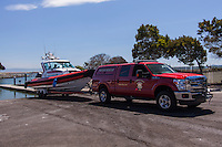 Alameda County Fire Department crew members execute a non-emergency launch of their water rescue craft at the boat launch at the San Leandro Marina on San Francisco Bay.