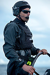 Emirates Team New Zealand helmsman Dean Barker sailing the AC72 on the Hauraki Gulf on the second day of sailing. A bang brings andend to sailing as a part in the wing gives way. 3/8/2012