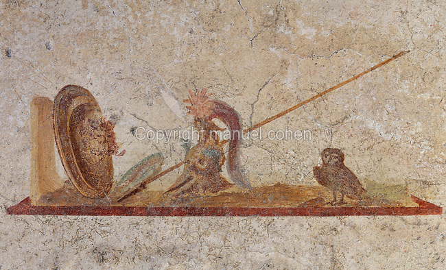Fresco detail of symbols of the goddess Athena, including an owl, spear, helmet and shield, in a cubiculum in the Casa dell Efebo, or House of the Ephebus, Pompeii, Italy. This is a large, sumptuously decorated house probably owned by a rich family, and named after the statue of the Ephebus found here. Pompeii is a Roman town which was destroyed and buried under 4-6 m of volcanic ash in the eruption of Mount Vesuvius in 79 AD. Buildings and artefacts were preserved in the ash and have been excavated and restored. Pompeii is listed as a UNESCO World Heritage Site. Picture by Manuel Cohen
