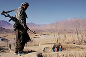 Maidan Shaher, Afghanistan<br /> November 25, 2001<br /> <br /> Maidan Shaher Province, District of Maidan Shaher<br /> <br /> The Taliban receive the Northern Alliance and journalist into the district of Maidan Shaher after a truce is struck between the two forces. Just two days ago the two fought each other in a serious battle over the territory.