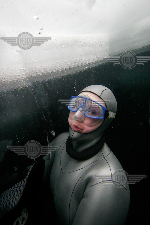 Elisabeth Kristoffersen (Norway) pose for a portrait under the ice. Freediving competition Oslo Ice Challenge at freshwater lake Lutvann outside the Norwegian capital Oslo. Atheletes, including current and former world champions, entered a hole in the ice to compete. The participants reached depths down to 52 meters below the surface.