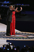 United States President Barack Obama and first lady Michelle Obama arrive for the Commander-In-Chief Ball at the Walter Washington Convention Center January 21, 2013 in Washington, DC. President Obama started his second term by taking the Oath of Office earlier in the day during a ceremony on the West Front of the U.S. Capitol. .Credit: Chip Somodevilla / Pool via CNP