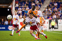 Connor Lade (16) of the New York Red Bulls and Macoumba Kandji (9) of the Houston Dynamo battle for the ball. The New York Red Bulls defeated the Houston Dynamo 2-0 during a Major League Soccer (MLS) match at Red Bull Arena in Harrison, NJ, on August 10, 2012.