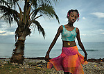 """Romage Jean Louis, a member of Nouvel Etwal - Haitian Kreyol for """"New Stars"""" - dances on the beach at Jacmel, Haiti. Nouvel Etwal is a dance and creative movement group of 16 girls from age 8 to 13, based in the southern village of Mizak. According to Valerie Mossman-Celestin, an organizer of the group, """"Nouvel Etwal seeks to empowers girls to be self-confident and creative. The girls learn flexibility, discipline and teamwork, lessons they also need for life. Nouvel Etwal promotes health, well-being and enhanced self-worth. The girls are encouraged to live into a brighter future where girls and women are valued,  educated, and have equal opportunity to achieve their potential."""""""