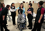 """Brandy Brock demonstrates a hair-cutting technique on a mannequin for her students at Somerset Community College in London, Ky., on Thursday, Oct. 25, 2012. """"It's nice that I can stand up in front of the class in the morning,"""" Brock said. Photo by Tessa Lighty"""