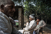 53 year old, Badrinath Singh, (centre) father of the rape victim speaks while his uncles sit around him during an interview in his ancestral house in Medawar Kalan in Ballia district of Uttar Pradesh, India. Photo: Sanjit Das/Panos for Der Spiegel