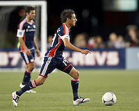 Second half substitute New England Revolution forward Diego Fagundez (14) dribbles. In a Major League Soccer (MLS) match, the New England Revolution defeated Vancouver Whitecaps FC, 4-1, at Gillette Stadium on May 12, 2012.