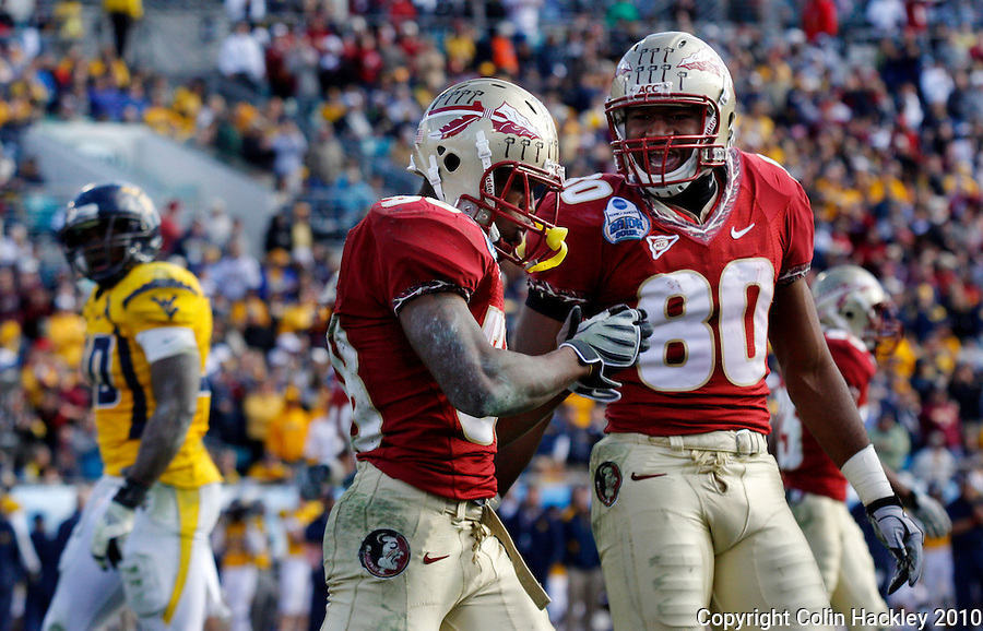 JACKSONVILLE, FL 1/1/10-FSU-WV FB CH55-Florida State's Jermaine Thomas, left, and Jarmon Fortson celebrate Thomas' touchdown against West Virginia during second half Gator Bowl action Friday in Jacksonville, Fla. The Seminoles beat the Mountaineers 33-21..COLIN HACKLEY PHOTO
