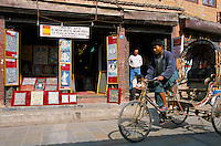 One of many Thangka shop in Durbari Square in Kathmandu. The lamas who paint thangkas use painting as a form of spiritual education and can spend up to 9 months on each canvas. Thangkas are seen hanging in every temple, monastery and family shrine in Tibet and Nepal.