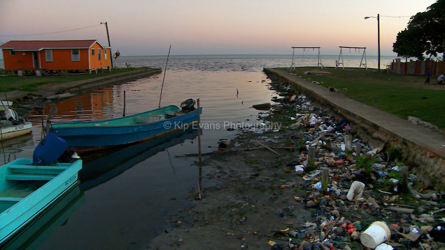 Trash lines a waterway in Belize City.