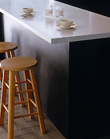 The overhang of this kitchen island work surface creates an area for informal dning