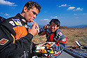 French Cyril Despres and Yoshio-san eat their lunch box after a ride at the foot of Mount Fuji (Japan) on November 2001. (Photo credit Laurent Benchana/Nippon News)