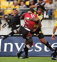 Ma'a Nonu tackles Lions winger Wandile Mjekevu during the Super 14 rugby match between the Hurricanes and Lions at Westpac Stadium, Wellington, New Zealand on Saturday, 27 February 2010. Photo: Dave Lintott / lintottphoto.co.nz
