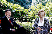 Washington, DC - (FILE) -- Prime Minister Margaret Thatcher of the United Kingdom, right, visits United States President Ronald Reagan, left, in the Rose Garden at the White House in Washington, D.C. on Friday, July 17, 1987.  .Credit: Howard L. Sachs - CNP