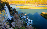 Idaho, East, Swan Valley. Fall River Falls cascades into the South Fork of the Snake River in autumn.